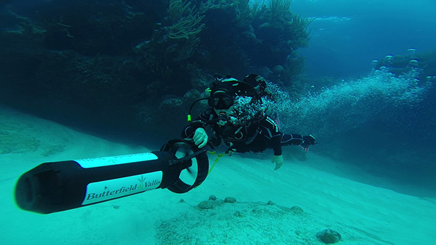 <p> 	Dr. Gretchen Goodbody-Gringley on a diver propulsion vehicle (DPV) that allows her to cover more ground while lionfish hunting at depth, and particularly useful when encountering strong currents at depth.</p>