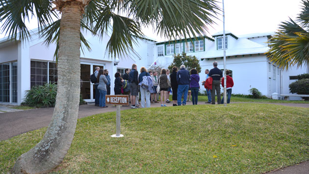 <p> 	A group of people wait outside Reception at BIOS.</p>