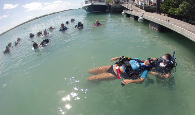 "<p> 	Fall student, Ashley Powell, practices her rescue diver skills on an ""unconscious"" Sarah Miller. </p>"