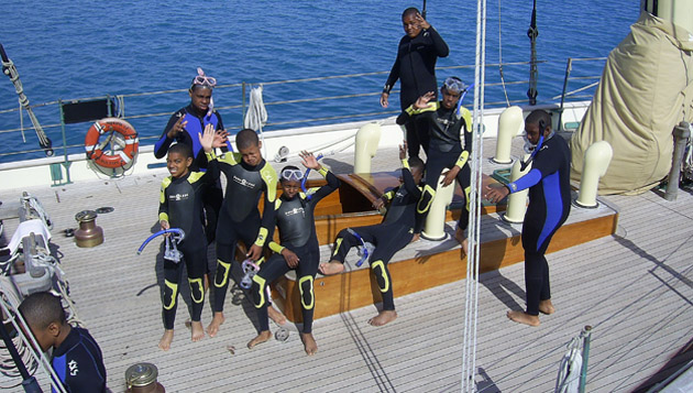 <p> 	Middle school students about the&nbsp;<em>Spirit of Bermuda</em> prepare to go snorkeling.</p>