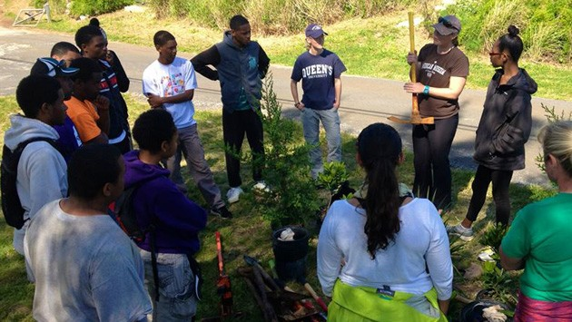 <p> 	Kaitlin Baird, BIOS science educator, gives instructions to Raleigh participants before beginning their environmental project.</p>
